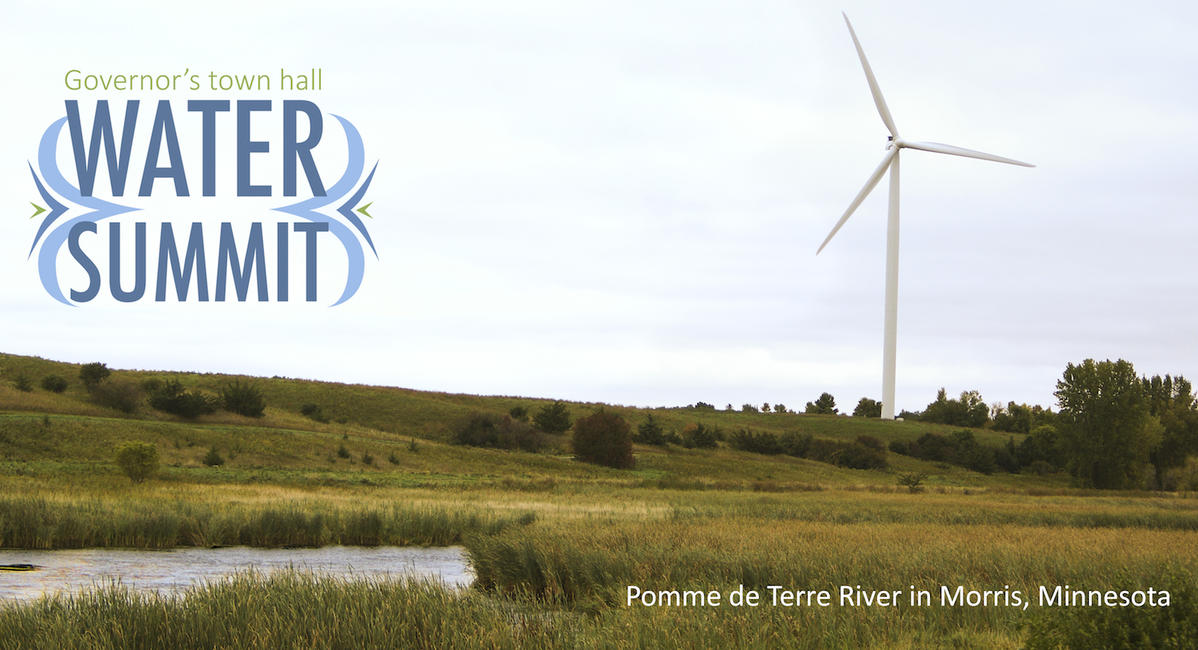 """A photo of a wind turbine with a """"Water Summit"""" logo"""