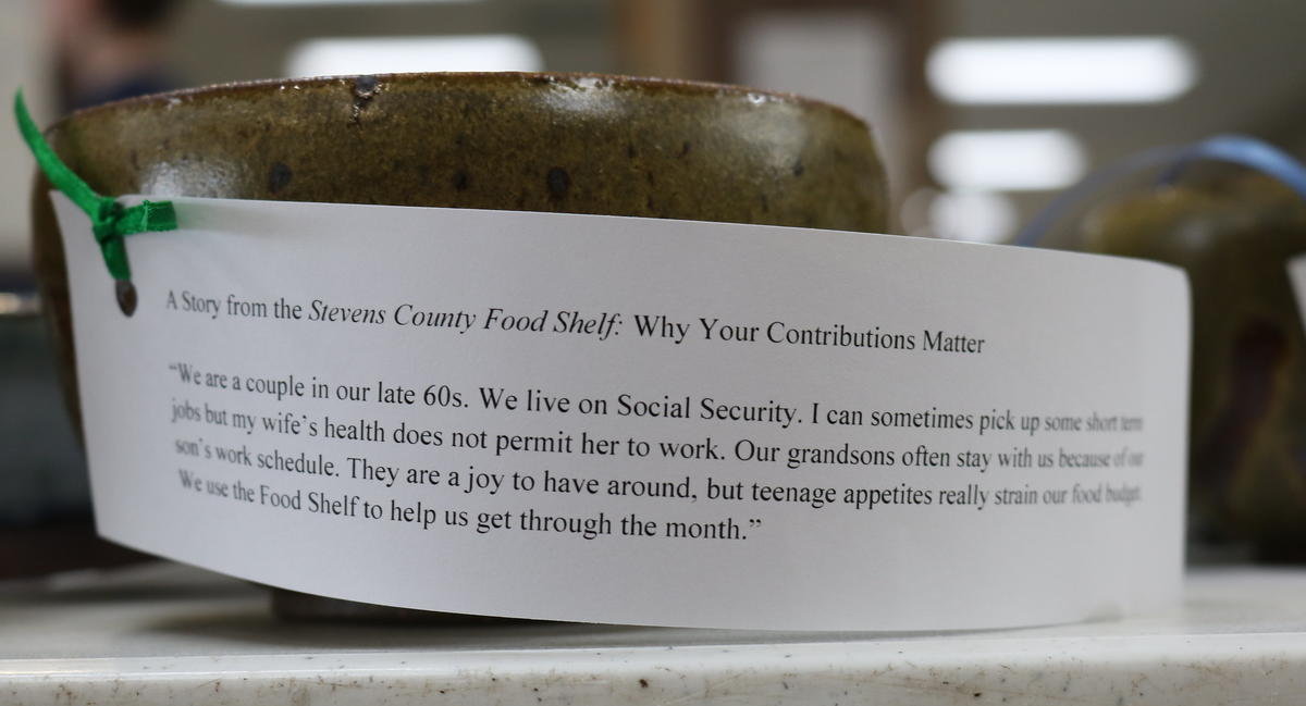 A photo of a ceramic bowl with a note that includes a story on the impact of donations to the food shelf