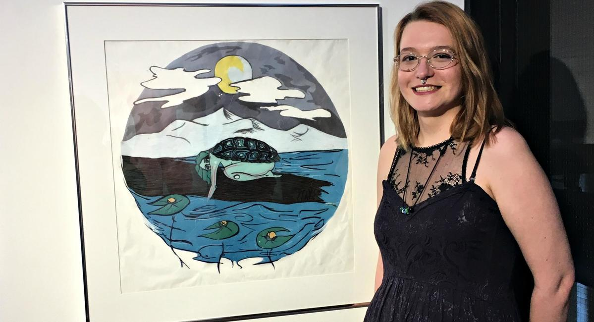 Emily Klarer next to her artwork