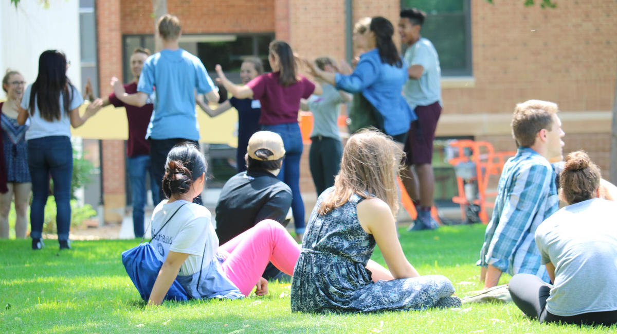 Students on the UMN Morris campus mall on a sunny summer day