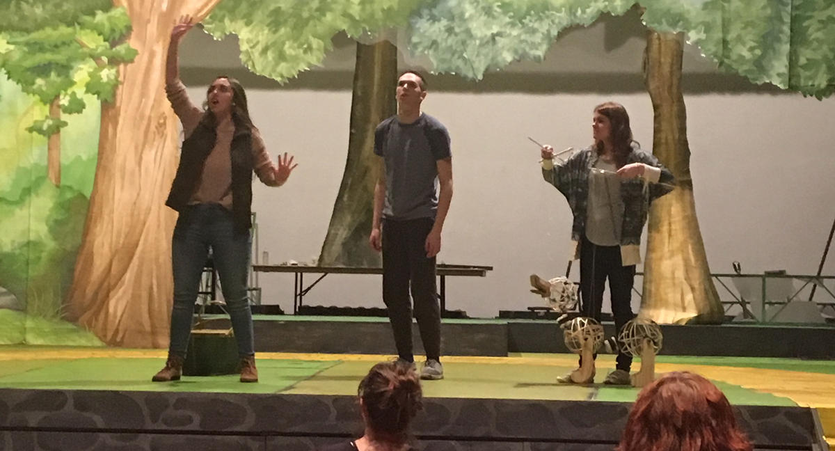 Actors onstage rehearsing The Wonderful Wizard of Oz