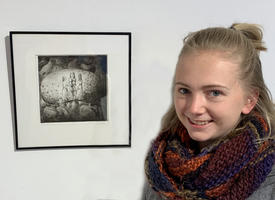 "Anneliese Tatham with her ""Seed Stories"" artwork"