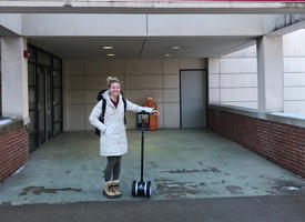 "Emily Ciesynski '19, Blaine, with telepresence robot ""Cooper"" outside the UMN Morris Student Center."