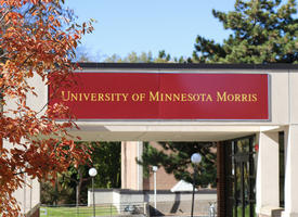 University of Minnesota, Morris student center in the background, fall leaves in the foreground