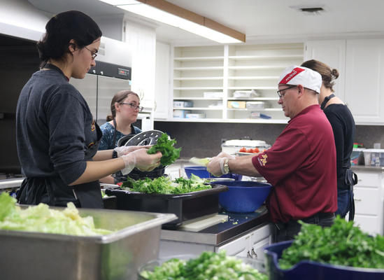 Volunteers cooking in a commercial kitchen